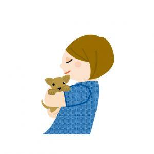 優しく犬を抱っこ